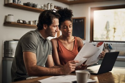 couple looking at papers
